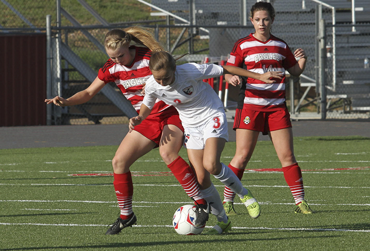 Jessica Ringstaff and Wimberley's Emma Sprague clash over the ball during the Lady Eagles' 1-0 win. (photo by Moses Leos, Hays County Free Press)