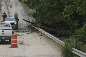 High waters damaged the southbound access road bridge over Salado Creek. The northbound access road and mainlanes are on the new construction and suffered no damage during the heavy rains and flooding this week. (Photo by Royce Wiggin)