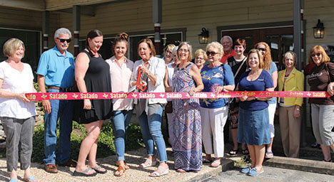 New owners cut ribbon at Susan Maries