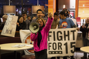 Workers plan to go on strike demanding living wages on tax day. Some employees made gains in recent weeks when Walmart and McDonald's announced pay raises. Photo credit: Bryan MacCormack/Left In Focus.