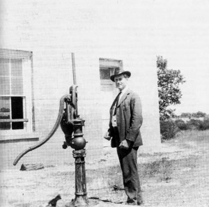 An unidentified man is shown in this undated photo of Salado College and its water pump. The foundation of the old well was excavated March 3, 2012.