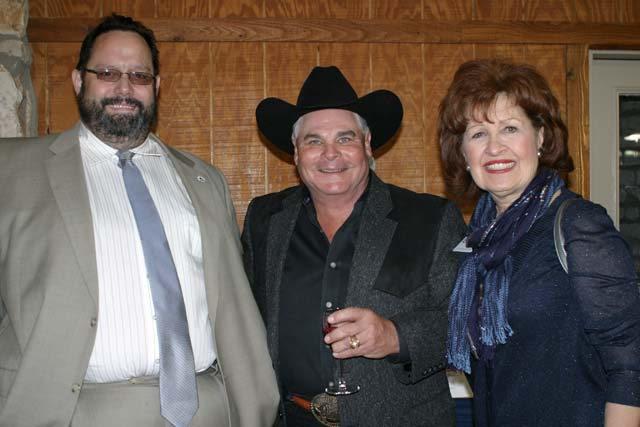 Bill Hall (center) is shown with 2015 Salado Chamber of Commerce Chairman Tim Fleischer and Cheryll Hassman, from Cong. John Carter's office before the Chamber of Commerce Banquet. He gaveled an auction of five items that brought in almost $10,000. A class for 10 donated by The Range at the Barton House brought in $5,000 in a bidding war between Billy Helm of Lone Star Grading and Donnie RIngler of Don RIngler Automotive GRoup.
